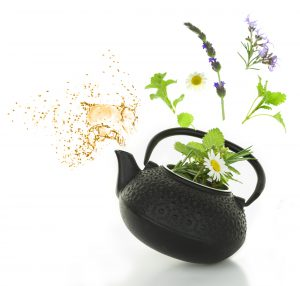 Teapot with bouquet of various herbs and splash isolated